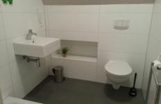 Das Badezimmer im Appartement 1
